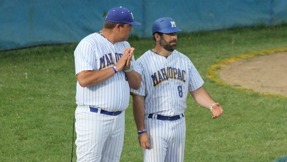 Myckie Lugbauer (left) talks with former Mahopac baseball