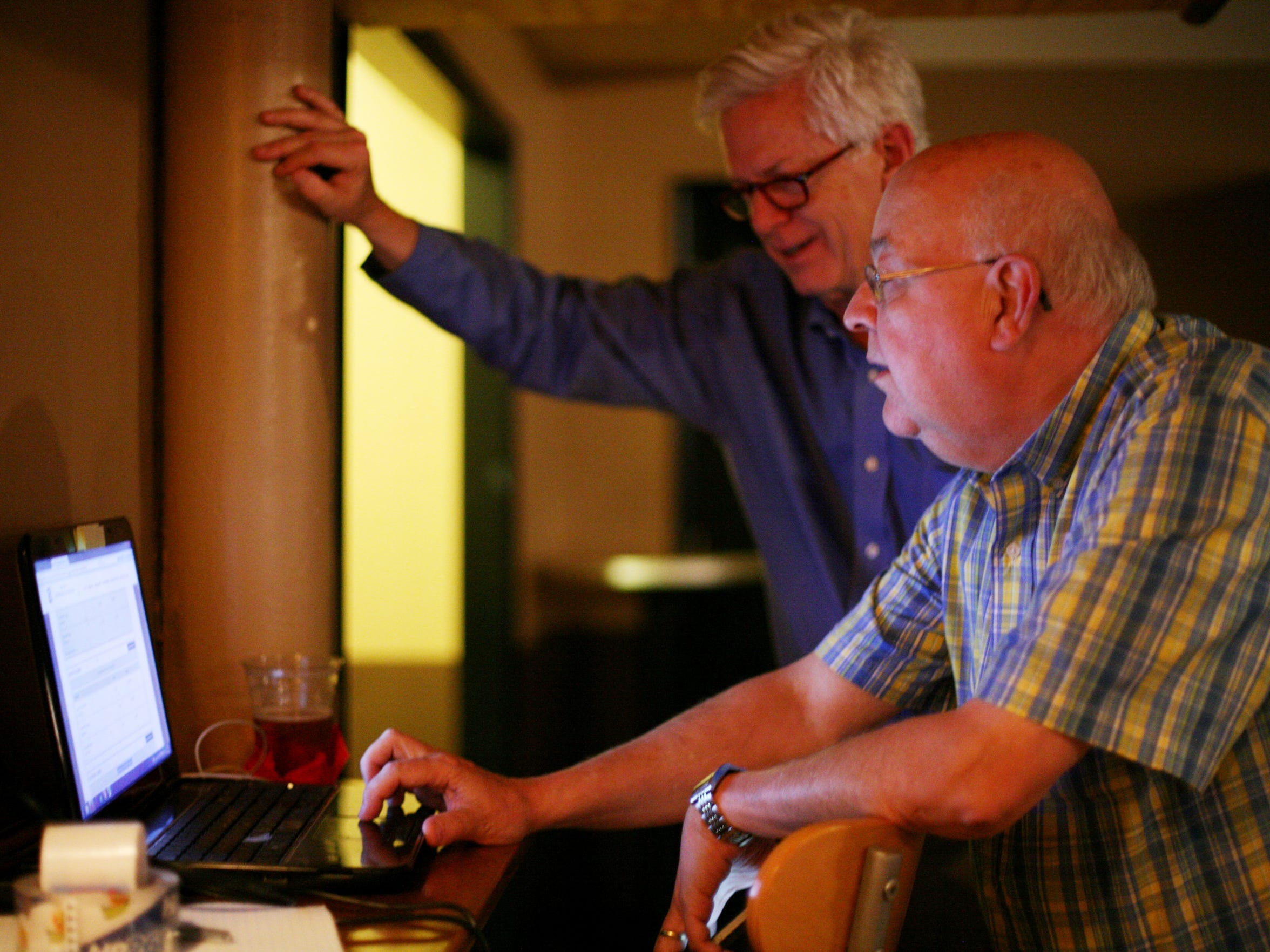 Campaign aide, Boyd Marcus, right, of Richmond, and Tony Smith, of Staunton, monitor the poll numbers of the District 24 state Senate seat Republican primary at the Clocktower Restaurant & Bar in downtown Staunton on Tuesday, June 9, 2015 for Hanger's campaign party.
