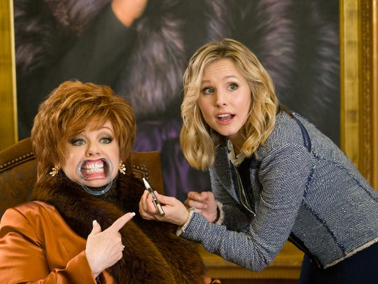 Melissa McCarthy, left, and Kristen Bell in a scene