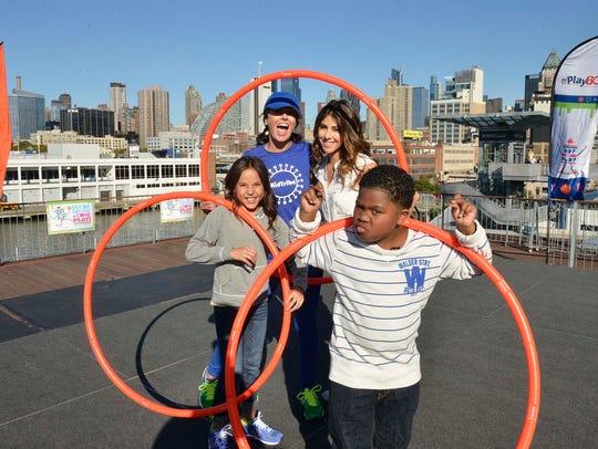 Breanna Yde, Kellee McQuinn (in blue hat), Daniella