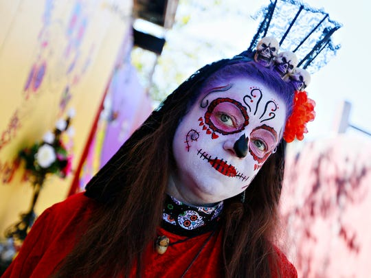 La Muerte (Rio Lacour) welcomes guests to the Horror
