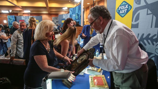 Dean Armentrout appraises Cathedral City resident Shirley's clock for $150.00. Photo taken at the Antiques Roadshow's stop in Palm Springs, CA on Saturday, August 6, 2016.