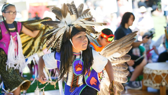 Jessi Soliz dances the crow hop as members of the Native American Cross Cultural Association perform at the 20th annual World Beat Festival on Saturday, June 24, 2017, at Riverfront Park in Salem, Ore.