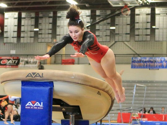 Canton's Katherine Nadjuk performs on vault during Saturday's invite.