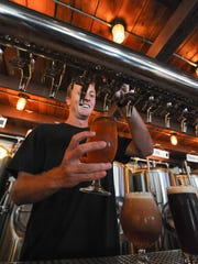Devin Medd pours glasses of beer at Dewey Beach Beer Co. in Dewey Beach.