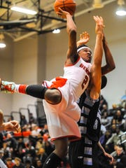 Bennett High's Jorden Duffy shoots while fouled by a Huntingtown player at home.