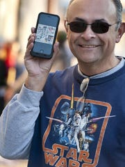 """Art Zepeda of Visalia made a collage of pictures on his phone from his Star Wars movie experiences in 1980, 2002 and Thursday while waiting with other fans for the first showings of """"Star Wars: The Force Awakens"""" in Visalia on Thursday, December 17, 2015."""