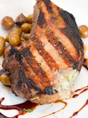 Smoked and grilled pork chop at Red Feather Kitchen & Wine Bar in Oakley.
