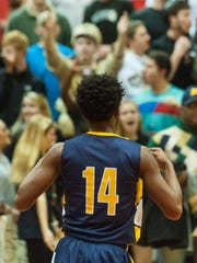 WARRIORS KEEP ROLLING: Pocomoke guard Dajour Mills flashes his jersey at the James M. Bennett Bleacher Creatures after sealing a win against the Clippers at James M. Bennett.