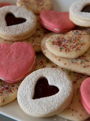 Linzer cookies, sugar cookies and heart sandwiches. Mel Vidana and Nate Guevara are the owners of Mel's Famous Bake Shop. Photo taken on Monday, February 9, 2015.