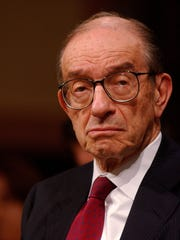 Federal Reserve Board Chairman Alan Greenspan answers a question during testimony before the Senate Banking Committee in Washington in February 2005.