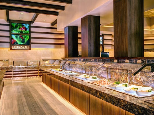 The reimagined salad bar encompasses greens and salad components, composed salads, a dozen dressings, an arrangement of breads, custom salads, and miniatures like Korean noodle salad in small tapering glass bowls. Plates are chilled.