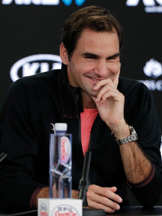 Switzerland's Roger Federer smiles during a press conference following his semifinal win over South Korea's Hyeon Chung who retired injured at the Australian Open tennis championships in Melbourne, Australia, Friday, Jan. 26, 2018. (AP Photo/Vincent Thian)