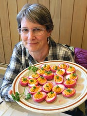 Judy Flegel's deviled eggs are pink from pickling in beet juice.