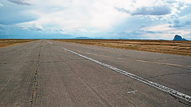 The Shiprock Airstrip is seen on July 31, 2014, off of U.S. Highway 491 south of Shiprock. The Federal Aviation Administration has awarded the Navajo Nation two grants worth $580,000 to renovate the airstrip.
