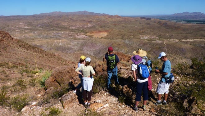 Hikers on Picacho Peak enjoy the views of the Prehistoric Trackways National Monument and the Mesilla Valley in the distance.