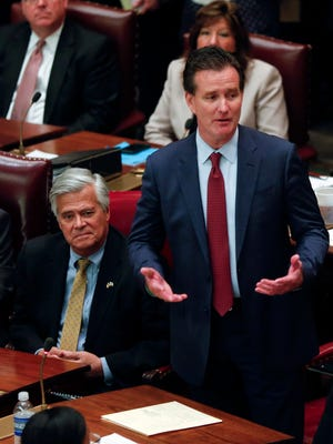 New N.Y. Senate Majority Leader John Flanagan, R-Smithtown, speaks in the Senate Chamber at the Capitol on Monday, May 11, 2015, in Albany. Flanagan replaces Republican Dean Skelos, left, who resigned his position as leader after his arrest on federal corruption charges.