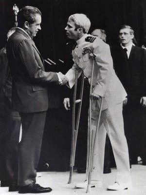 President Nixon welcomes back POW John McCain in 1973.
