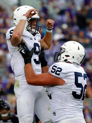 Penn State quarterback Trace McSorley, left, celebrates with offensive lineman Ryan Bates during the second half of an NCAA college football game against Northwestern in Evanston, Ill., Saturday, Oct. 7, 2017. Penn State won 31-7. (AP Photo/Nam Y. Huh)