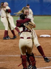 Florida State starting pitcher Meghan King celebrates with catcher Anna Shelnutt after Florida State defeated Washington to win the title.