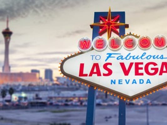 las-vegas-sign-with-strip-in-background_large.jpg