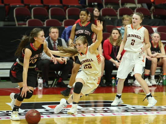 Grinnell's Megan Doty, 22, defends against Mason City's Megan Meyer, 10, during the Tigers' 70-51 win in the quarterfinals of the Class 4A girls state basketball tournament at Wells Fargo Arena in Des Moines on Monday, Feb. 27.