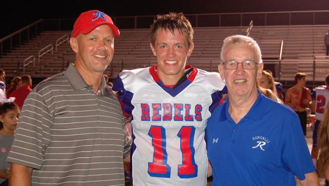 BJ O'Connor,(Roncalli QB in 1990) , his son Derek, (Roncalli senior QB now, in 2016) and BJ's father Bernie (QB in 1961 and '62 at Sacred Heart, a precursor to Roncalli)  Grandfather, son, grandson. All three QB's for Roncalli, or its predecessor school. All three voted co-captains by their team.
