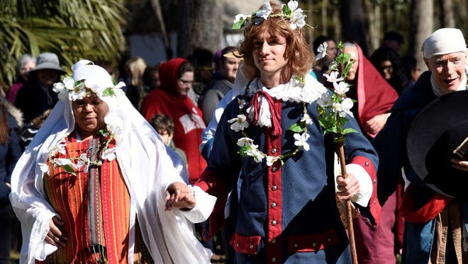 """In character, members of the Theater With a Mission acting troupe form a procession as part of the """"Historic Indian-Spanish Wedding."""""""