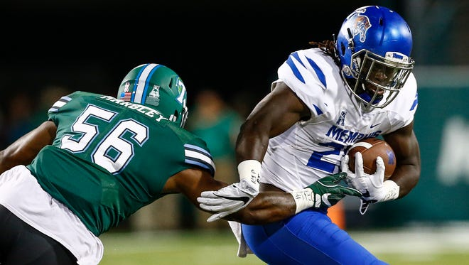 University of Memphis running back Doroland Dorceus (right) runs away from Tulane University defender Rae Juan Marbley (left) during second quarter action at Yulman Stadium in New Orleans.