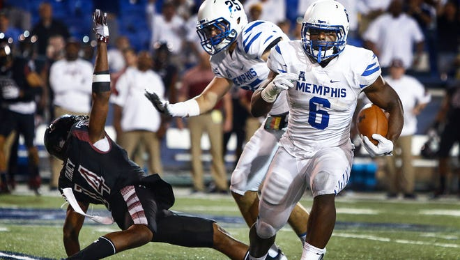 University of Memphis linebacker Genard Avery (right) returns an interception for a 23-yard touchdown against Temple during third quarter action at Liberty Bowl Memorial Stadium.