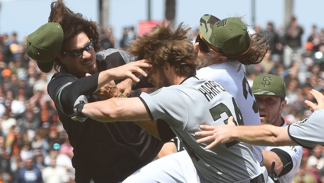 As Jeff Samardzija, left, Bryce Harper and Mike Morse converged on the infield, Morse's interference possibly prevented bodily harm to Harper, but Morse suffered a career-ending concussion.