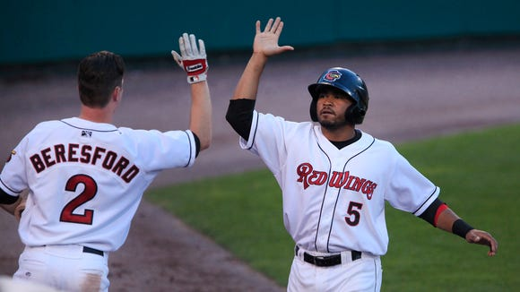 Red Wings Eric Farris, right, is congratulated by teammate James Beresford after Farris scored the fifth run.