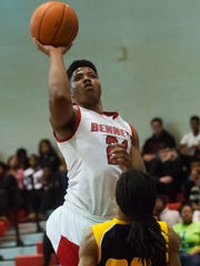James M. Bennett forward Mike Jean-Charles (21) takes