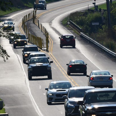 Cars pass along a section of Buchanan Trail East on