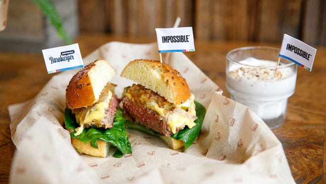 Bareburger serves its Impossible Burger with American cheese, dill pickles, little gem lettuce, stout onions and special sauce on a brioche bun.