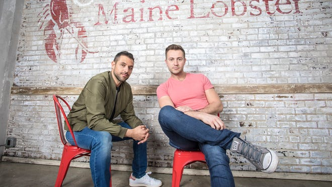 Sabin Lomac, left, and Jim Tselikis, real-life cousins and founders of Cousins Maine Lobster, which has food trucks in 19 cities and six brick-and-mortar restaurants slated to open by the end of 2018 through their franchise.
