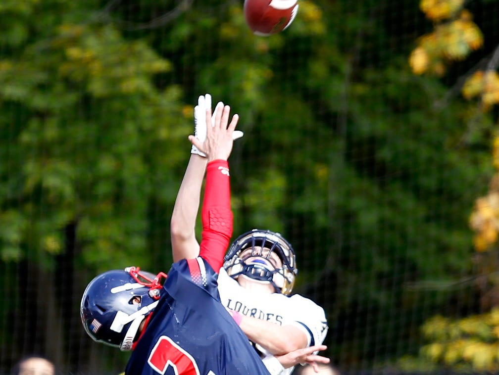 Eastchester's John Archidiacono (2) blocks a pass intended for Lourdes receiver Corey Mulalley (4) during their 19-27 loss to Our Lady of Lourdes High School in the class A semi-final football game in Eastchester on Saturday, Oct. 31, 2015.