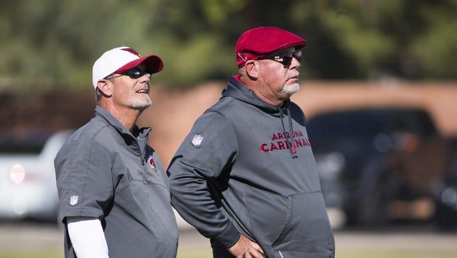Arizona Cardinals tight ends coach Rick Christophel (left) and head coach Bruce Arians watch practice in Tempe, Ariz. November 23, 2016.