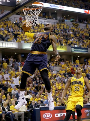 Cleveland Cavaliers forward LeBron James (23) slams down two points in the second half  of their NBA playoff game Thursday, April 20, 2017, evening at Bankers Life Fieldhouse. The Cleveland Cavaliers defeated the Indiana Pacers 119-114.
