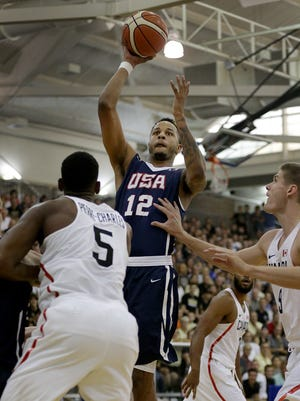 Team USA's Vincent Edwards (12) shoots over Team Canada's Jean Emmanuel Pierre-Charles (5) in the first half during the World University Games basketball game at Carmel High School Friday evening, August 11, 2017.