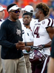 Texas A&M coach Kevin Sumlin and receiver Camron Buckley.