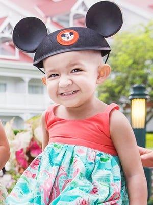 Summer on a trip to Walt Disney World in Orlando, Fla., three months before her death.