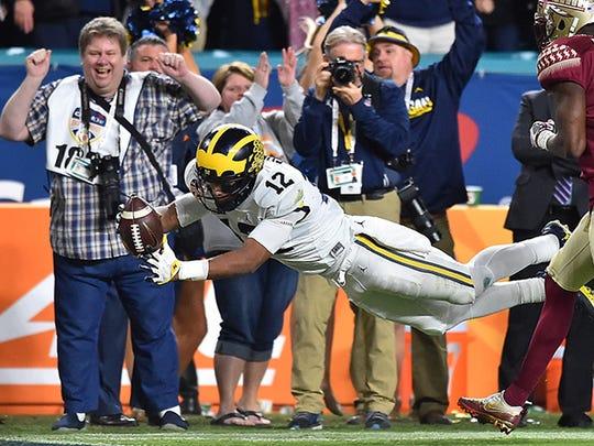 Michigan Wolverines running back Chris Evans (12) was a star at Ben Davis.