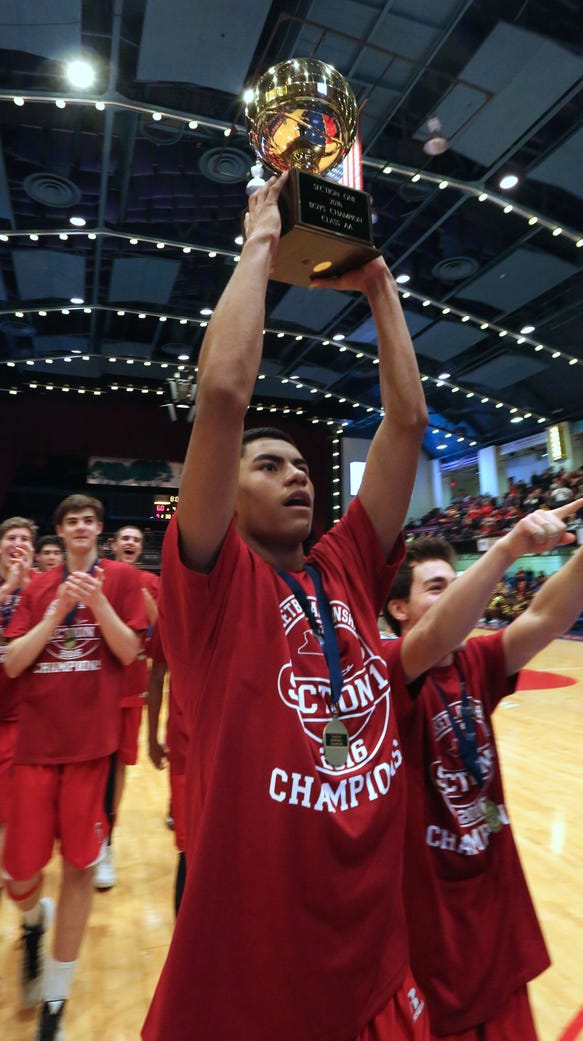 Fox Lane's Alex Olsen holds the gold ball after their