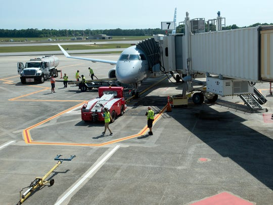 Ground crews at Pensacola International Airport prepare an American Airlines jet for departure to Washington, D.C., on April 4, 2017.