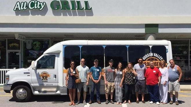 A group of tasters is shown in front of the Hudson Valley Craft Beer Tours bus at All City Grill in LaGrangeville.
