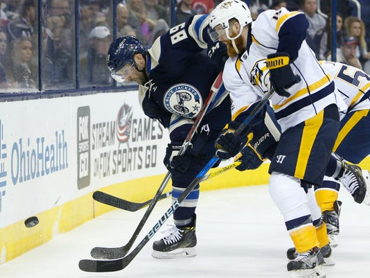 Columbus Blue Jackets' Sam Gagner, left, and Nashville Predators' Ryan Ellis fight for a loose puck during the second period of an NHL hockey game, Sunday, Feb. 19, 2017, in Columbus, Ohio. (AP Photo/Jay LaPrete)