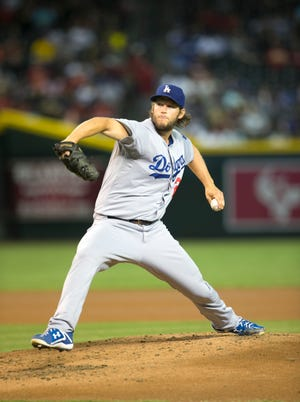 Dodgers pitcher Clayton Kershaw pitches against the Diamondbacks during the first inning of the MLB game at Chase Field in Phoenix on Wednesday, August 27, 2014.