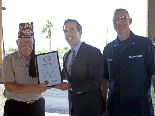 Texas Land Commissioner George P. Bush awards a certificate