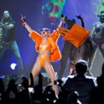 Singer Miley Cyrus performs last year in Mexico City. The former Disney star, once engaged to Liam Hemsworth and newly split from Patrick Schwarzenegger, says she's flexible about who she'll love.